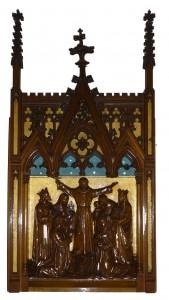 Deel van het altaarretabel dat thans in de toegang naar de kapel hangt