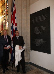 The 7th Earl of Malmesbury, descendant of George Carleton (l) unveils the stone with the names of the officers, assisted by Gary Johnson from the English embassy.